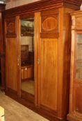 An Edwardian mahogany triple wardrobe W.184cm