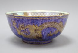 A Wedgwood lustre dragon bowl designed by Daisy Makeig-Jones, the mottled blue exterior decorated