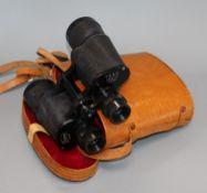 A pair of luminus 7 x 50 binoculars in leather case