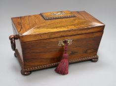 An early 19th century mother of pearl-inlaid rosewood sarcophagus tea caddy
