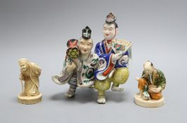 Three Japanese porcelain groups or figures