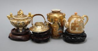 Four Satsuma miniature vessels and three hardwood stands tallest 9cm