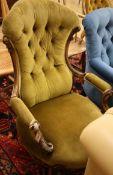 A Victorian walnut spoon back open armchair