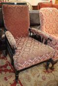 A late Victorian ebonised armchair