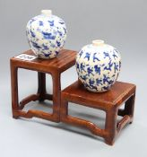 Two Chinese crackleglaze small blue and white vases, painted with figures, late 19th century plus