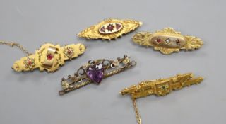 Five assorted early 20th century 9ct and gem set bar brooches.