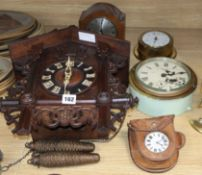 A cuckoo clock and four others