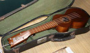 A Hawaii Kumalae Gold Award koa wood ukulele, cased length 22cm