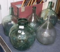 Six green glass carboys
