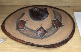 An Eastern straw and leather hat
