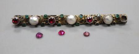 A 19th century Austro-Hungarian gilt white metal and gem set bar brooch, three stones loose, 69m.