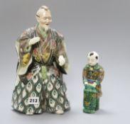 A Japanese Kutani figure of a Samurai general and a figure of a boy tallest 31cm