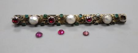 A 19th century Austro-Hungarian gilt white metal and gem set bar brooch, three stones loose, 69m.
