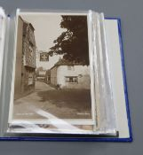 A collection of Edwardian and later postcards of Alfriston views, a stamp album and a collection