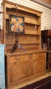 A 19th century pine dresser with boarded rack W.136cm