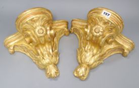 A pair of French gilt carved wood wall brackets width 27cm