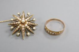 An Edwardian 15ct and seed pearl set starburst brooch and a Victorian 9ct and seed pearl ring.