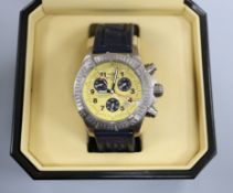 A gentleman's 2004 stainless steel Breitling Chronometre quartz wrist watch, with yellow dial and