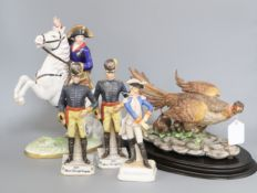 A Capodimonte limited edition model of a pheasant, on oval wood plinth, no. 664/1000 and four