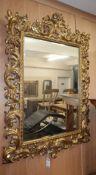 A modern gilt framed Florentine wall mirror, with a foliate border H.110cm