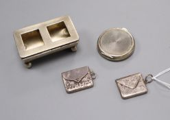 A silver double stamp box, two silver envelope stamp cases and a pill box.