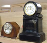 A late 19th century French ebonised mantel clock and a later oak mantel clock tallest 41cm
