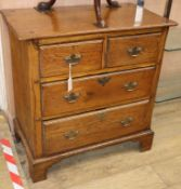 A George III style oak chest of drawers W.84cm