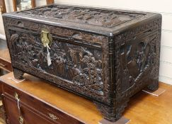A Chinese carved camphorwood trunk W.90cm