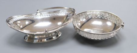 A George V pierced silver circular bonbon basket by Asprey & Co, London, 1913 and a similar