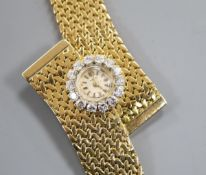 A stylish yellow metal and diamond set dress bracelet watch, 18.5cm.