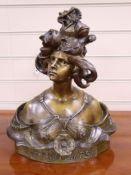 After Aurili Printemps. A bronzed bust of a lady, signed height 40cm