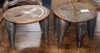 Two carved African tribal stools height 21cm