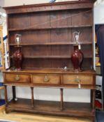 A mid 18th century oak pot board dresser W.180cm
