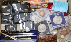 A quantity of mixed coins, pens, lighters, etc.
