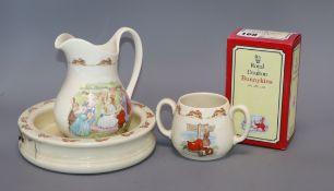A Bunnykins bowl jug and two handled mug together with twelve Bunnykins characters including: