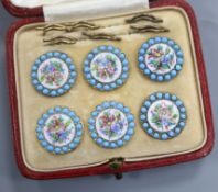 A cased set of six floral and turquoise enamel buttons.