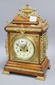 A late 19th century French cast brass mounted rosewood eight day mantel clock height 43cm