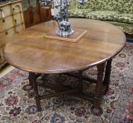 An 18th century style oak gateleg dining table 150cm extended