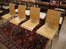 A set of four chrome and plywood chairs
