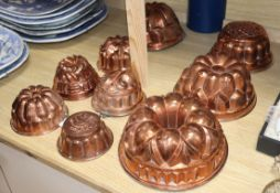 A collection of nine copper jelly moulds