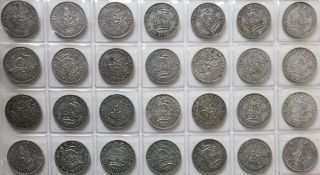 An album of assorted British coinage, including shillings, pennies, threepences etc.