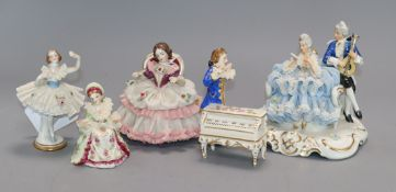 Five Dresden, Irish Dresden and other small lace figures, comprising a group of a couple singing and
