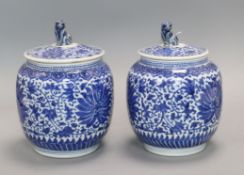 A pair of Chinese blue and white jars and covers, 19th century height 20cm