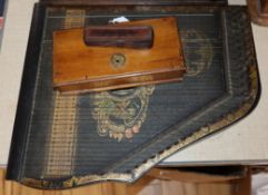 A leather cased portable surveying instrument, an oak cased set of balance scales and a zither