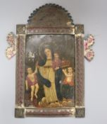 A Mexican Retablo icon on zinc, framed overall length 38.5cm