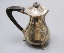 A George V hammered silver hot water pot, Charles Edwards, London, 1920, gross 11 oz.