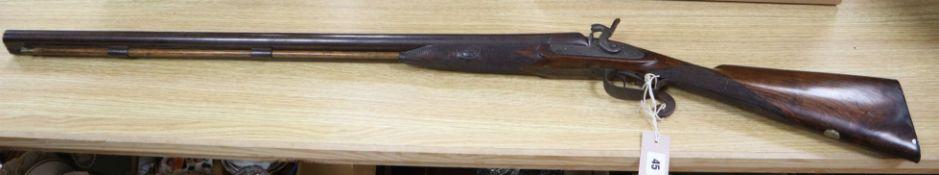 A 19th century twin barrel percussion cap shotgun overall length 109cm (a.f)
