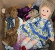 A collection of dolls and teddy bears