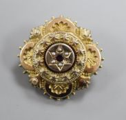A Victorian yellow metal, gem and seed pearl set brooch, with glazed back, 30mm.