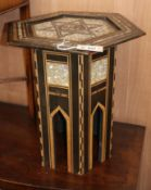 A Moorish mother of pearl inlaid hexagonal table W.48cm